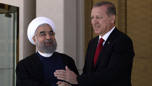 Rouhani calls for US exit from Syria in meeting with Russian, Turkish counterparts